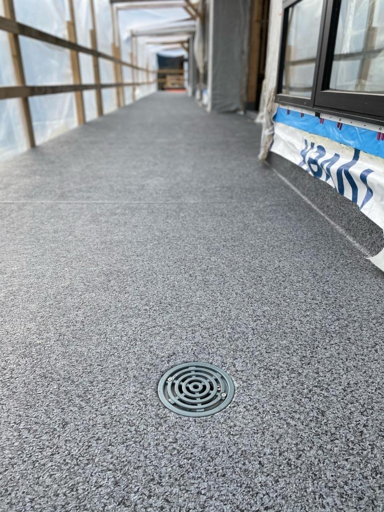 Vinyl Deck - 66 Granite Rock - with WDD-1 Flush Mount Deck Drains Installed