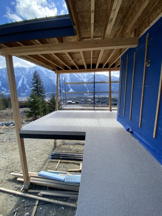 After - A new construction Passive House in Pemberton - Vinyl Decking Installation 66mil Beige Marble