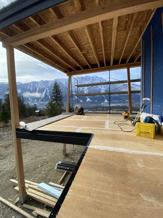Before - A new construction Passive House in Pemberton - Vinyl Decking Installation 66mil Beige Marble